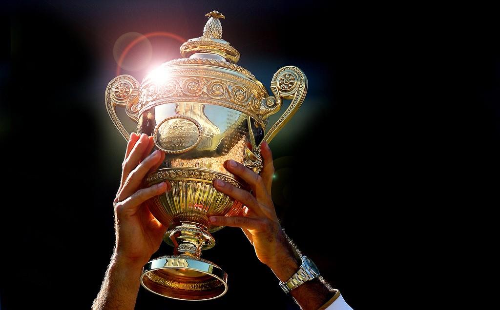 Roger Federer holds aloft the Wimbledon Mens Singles Trophy.